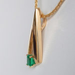 side view of yellow gold emerald slide pendant