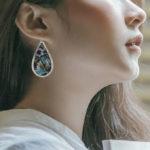 sterling silver colorful blue pear shaped drop earrings on model