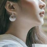 sterling silver indiri disc earrings on model