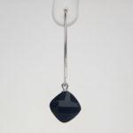 close up view of sterling silver onyx dangle earring