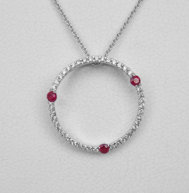 ruby and diamond circle pendant white gold