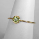 yellow gold peridot stacking ring