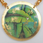 close up view of banana leaf yellow gold pendant