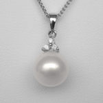 close up view of pearl and diamond pendant