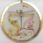 close up view of yellow gold dragonfly pendant