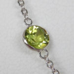 close of view of peridot station necklace