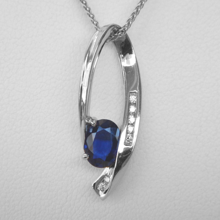 close up view of sapphire and diamond pendant