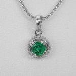 emerald and diamond pendant white gold