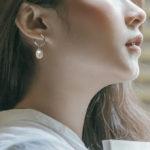 sterling silver pearl hoop earrings on model