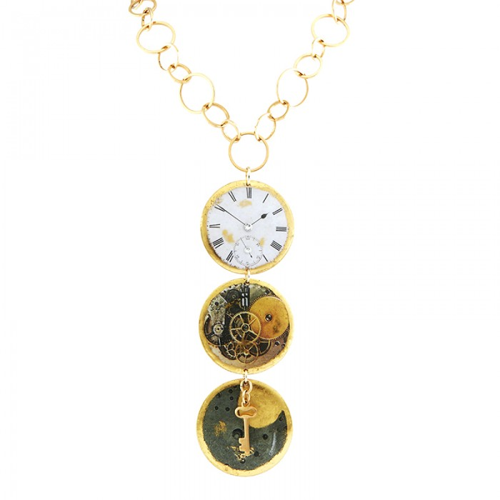 yellow gold leaf necklace with 3 time inspired discs hanging from the chain