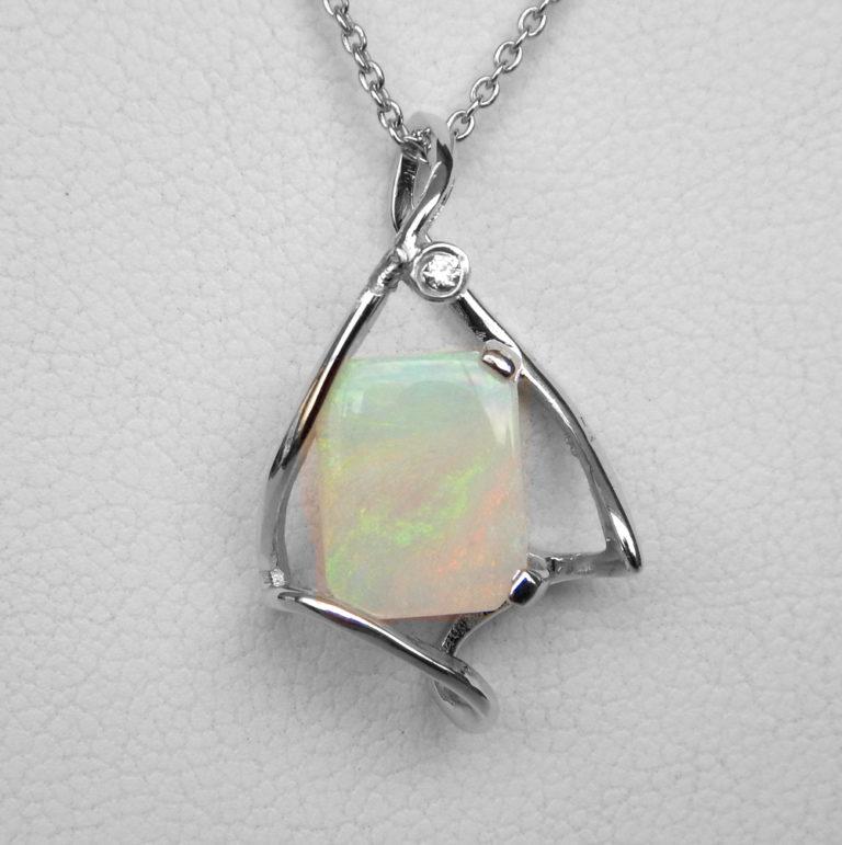 white gold opal and diamond pendant