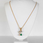 contemporary emerald and diamond necklace in yellow gold