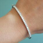 white gold diamond bangle bracelet on wrist