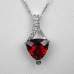 garnet and diamond white gold pendant