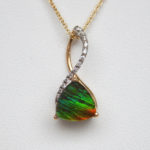 two tone gold ammolite and diamond pendant