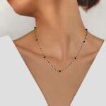white gold black diamond necklace on model