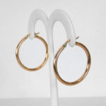 side view of yellow gold hoop earrings