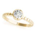 yellow gold bezel set diamond engagement ring