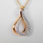 yellow gold diamond swirl pendant