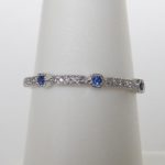white gold milgrain sapphire and diamond band