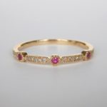 yellow gold ruby and diamond band with milgrain edges