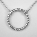 close of view of sterling silver circle necklace