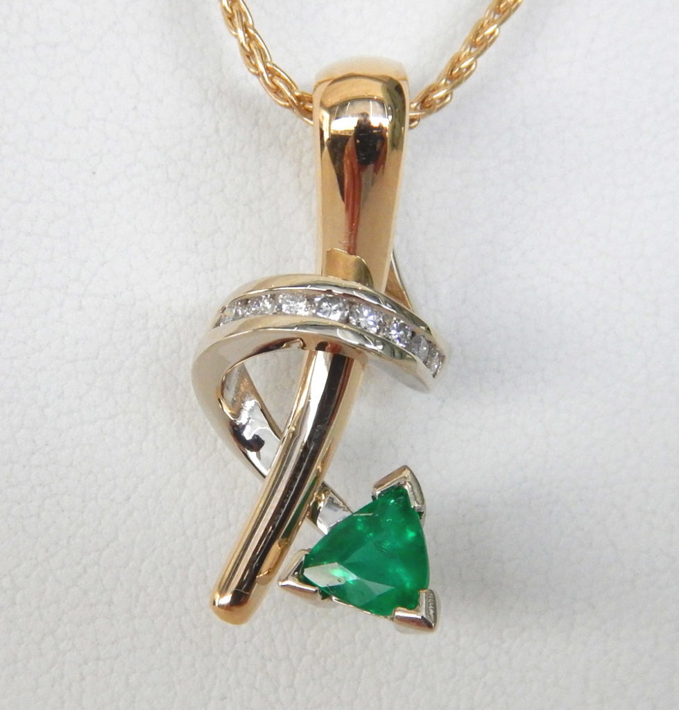 contemporary emerald and diamond pendant