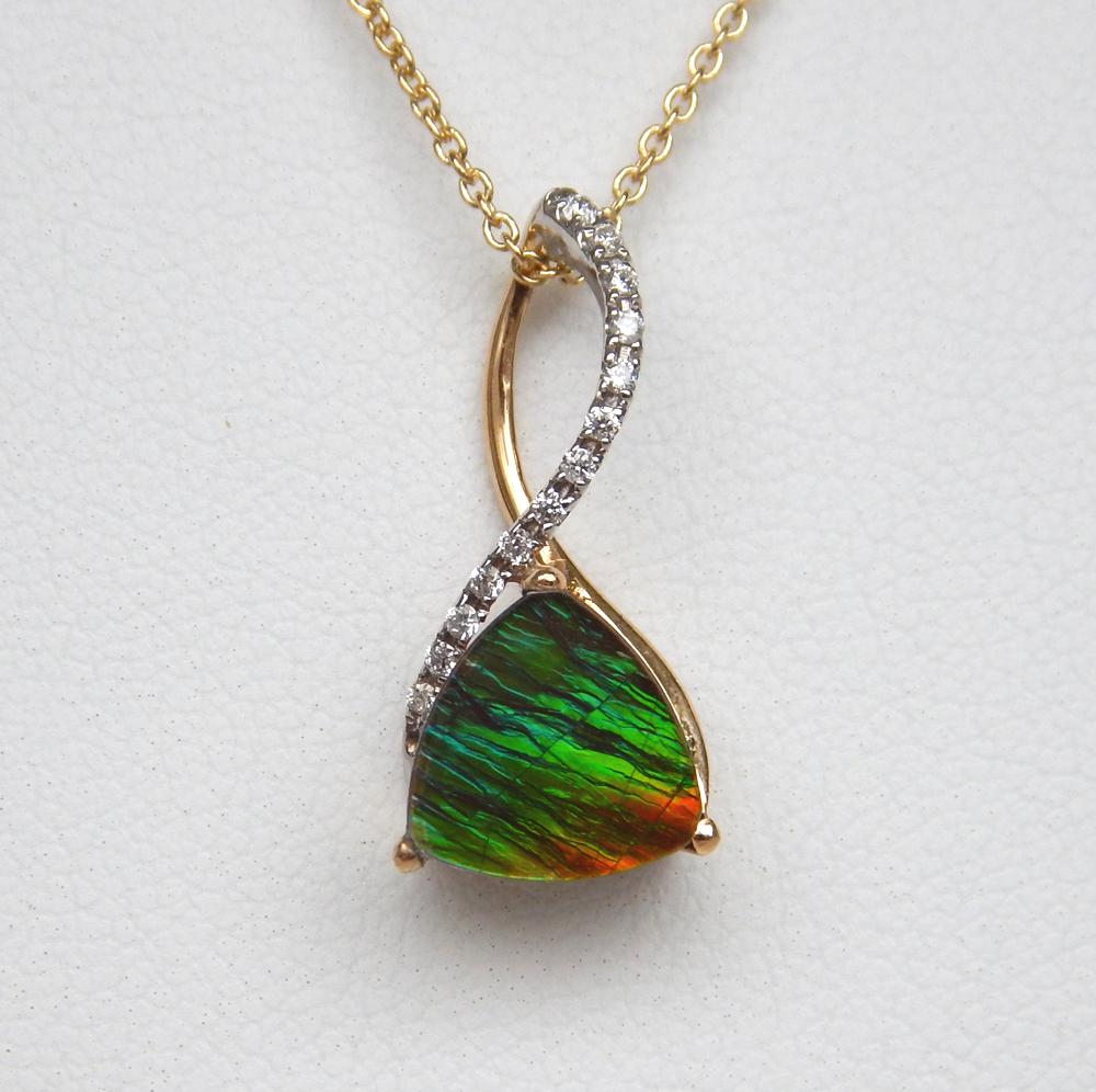 ammolite and diamond pendant in contemporary yellow gold setting