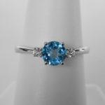 white gold blue topaz and diamond three stone ring