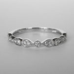 white gold pear and round shaped diamond band