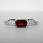 white gold emerald cut garnet ring with accent diamonds
