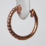 side view of rose gold diamond huggie earrings