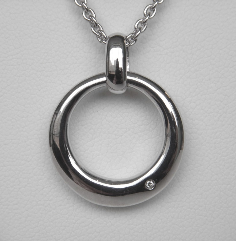 close up view of sterling silver single diamond circle pendant