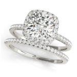 cushion cut diamond halo engagement ring with matching wedding band