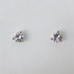 white gold diamond studs in martini setting