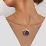 yellow gold sun and moon pendant on model