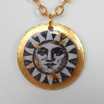 yellow gold leaf disc pendant with sun design