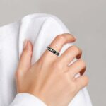 sterling silver black and white stacking ring on finger