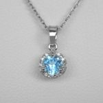 blue zircon and diamond halo pendant