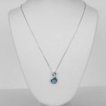 white gold blue zircon and diamond pendant on diamond cut cable chain