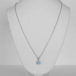 white gold blue zircon and diamond halo pendant on chain