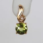 close up view of yellow gold peridot earring