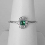 white gold emerald and diamond halo ring