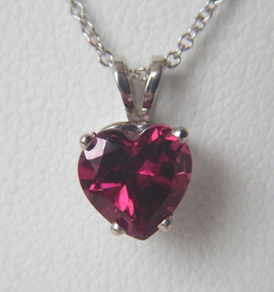 white gold garnet heart shaped pendant
