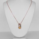 rose gold opal and diamond pendant on chain