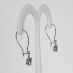 side view of white gold blue zircon and diamond wire earrings