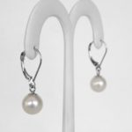 side view of white gold freshwater pearl dangle earrings
