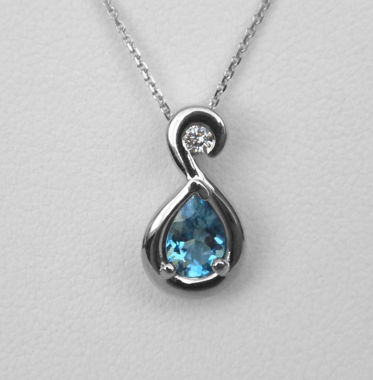 white gold blue zircon and diamond pendant
