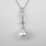 white gold pearl and diamond drop pendant