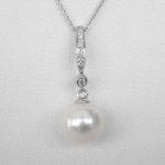 white gold pearl and diamond drop pendant